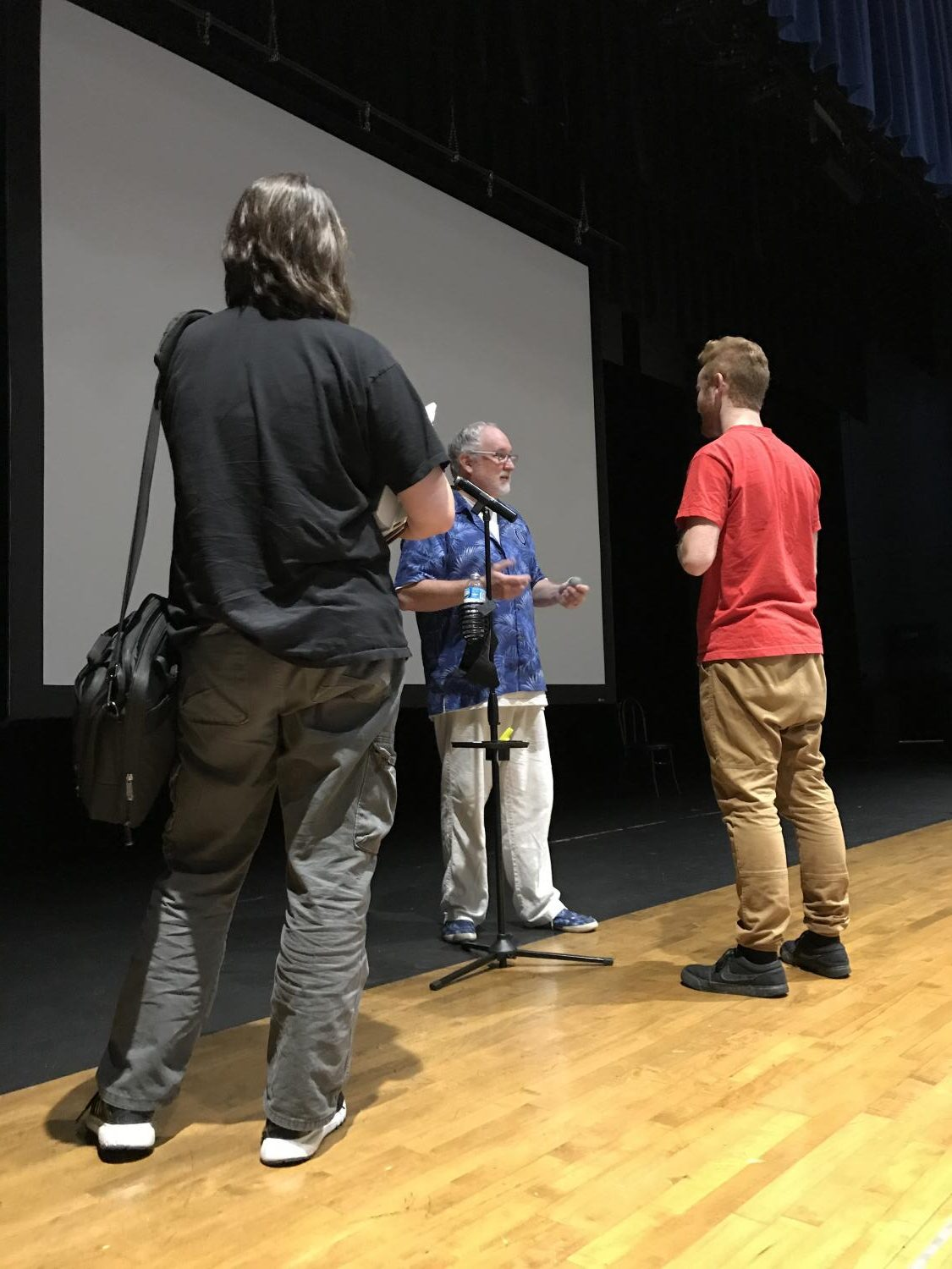 Motivational speaker Kevin Wanzer speaks to a couple of students after his three presentations in the large auditorium. Mr. Wanzer delivered a message of treating people with kindness and understanding.