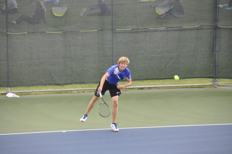 With+his+second+serve%2C+senior+Ethan+Radke+blisters+the+ball+at+Adams+Centrals+Jaxon+Rinkenberger.+Photo+by+Collin+Cowart