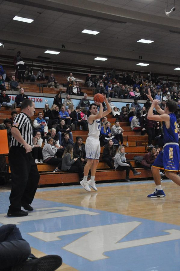 (14) Nathan Fish shoots a three against Homestead in the SAC Holiday Tournament .
