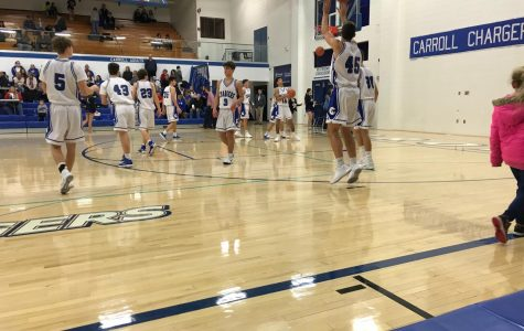 The JV Basketball team warms up at halftime during an January 2018 game. Junior Varsity playing time can give athletes the chance to get better and become strong enough to play varsity. Photo by Nol Beckley