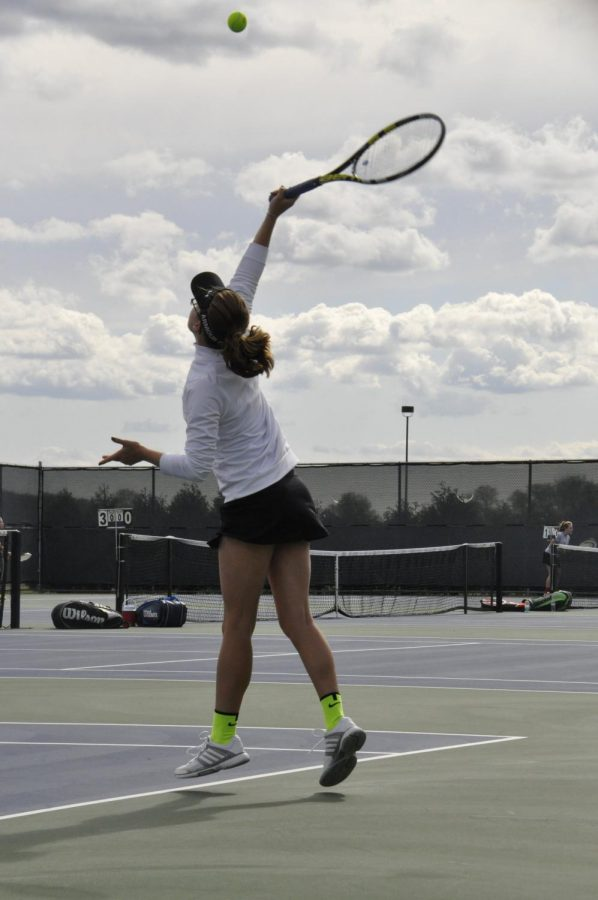 Mia+Toscos+serves+last+season.+Along+with+her+doubles+partner%2C+Lauren+VanWyngarden%2C+she+hopes+to+get+to+the+state+finals+again+this+year.+File+photo.