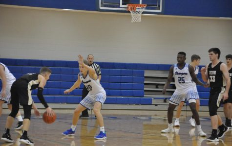 Seniors Preston Shearer and David Ejah lead the Chargers against Penn High School in an early season loss. Final score Penn 65-49. Photo by Malia Williams