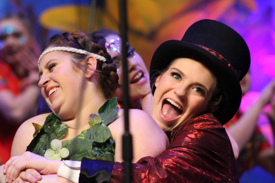"""Senior Jordyn Bilger (right), joined show choir her Sophomore year, as her love for travel and music drove her decision. """"I really love the bond that we are able to create with each other since we are together all of the time."""""""