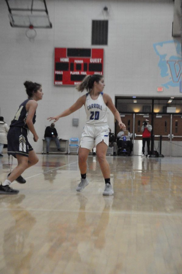 Junior Brianna Thomas keeps an eye on the ball while guarding her Dwenger opponent at the SAC tournament in December 2018. Photo by N. Beckley
