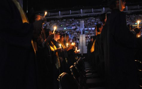 2019 graduates light candles to close out the last year's ceremony at the Allen County Memorial Coliseum. This year's graduation ceremony has been postponed because of the coronavirus outbreak.