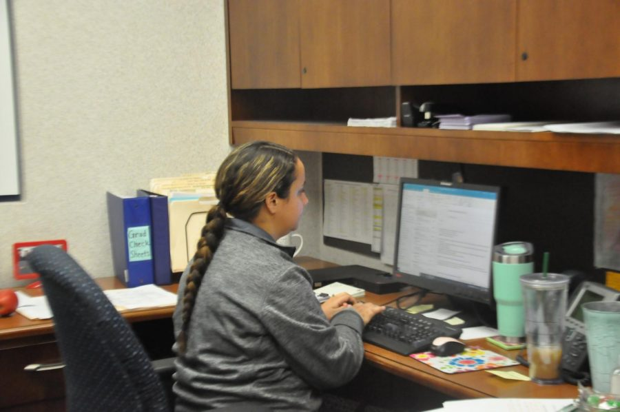 Ms. Megan Fizer, the junior guidance counselor, works at her desk. Mrs. Fizer covers junior students A-K.