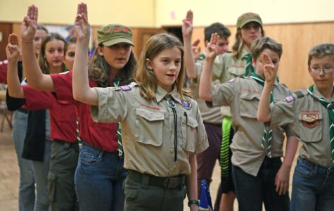 One of the first Girl Scout BSA troops being sworn in to the Boy Scouts. Courtesy of Creative Commons.