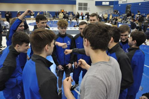 Before a series of dual meets in the fieldhouse, the team gets hyped up.