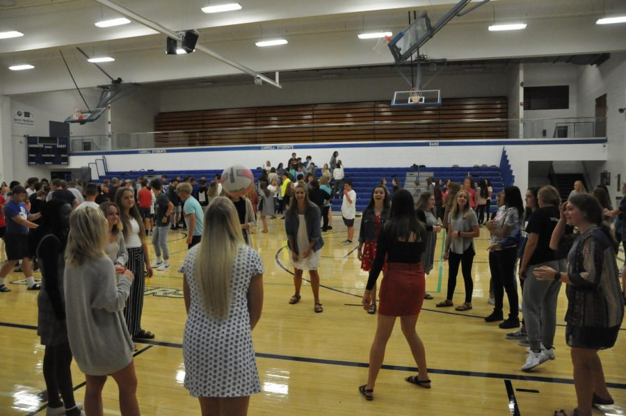 Members of Enlightened, is one of three religious groups at the school, gather in September 2019 in the Alumni gym.