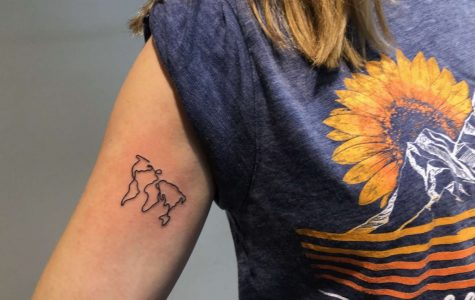 Because she cares about the environment, Senior Hannah Harper tattooed the continents on her arm.