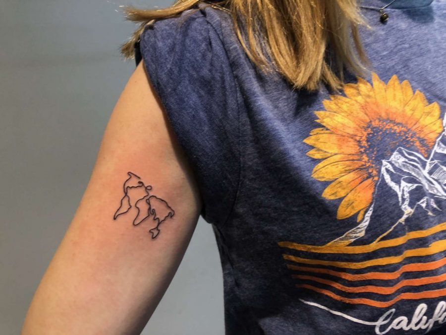 Because+she+cares+about+the+environment%2C+Senior+Hannah+Harper+tattooed+the+continents+on+her+arm.+