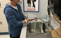Nurse Ann Kline demonstrates the proper way wash your hands. She recommended getting under your nails and scrubbing all the nooks and crannies in your hands. Wash for 20 seconds or about as long as it takes to sing