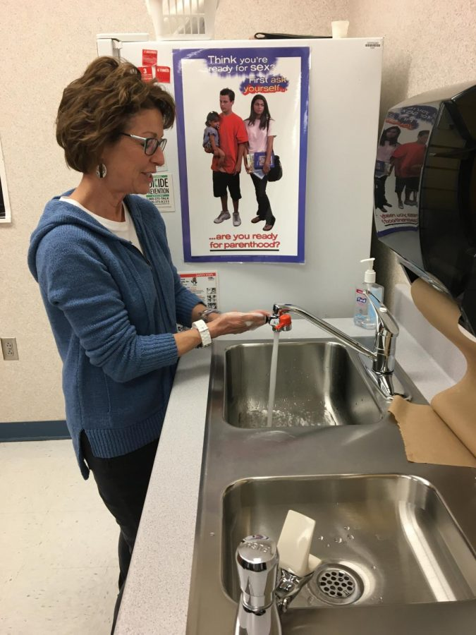 Nurse Ann Kline demonstrates the proper way wash your hands. She recommended getting under your nails and scrubbing all the nooks and crannies in your hands. Wash for 20 seconds or about as long as it takes to sing Happy Birthday.