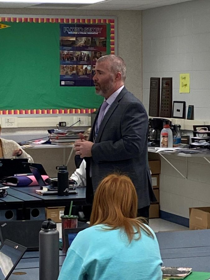 Principal Mr. Brandon Bitting visits the Charger Online classroom March 13 to discuss the possible school closing. Mr. Bitting visited nearly all the English classes to reassure students of the school's mission.