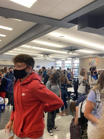 Waiting for 9:55 for the hallways to open, students pack in by the lunchroom doors. The recommend 6 feet social distancing is no where to be seen and most students talking with their friends have the noses hanging out of their masks. With the CDC recommendations students across the nation are wearing masks to slow down the spread of Coivd-19.