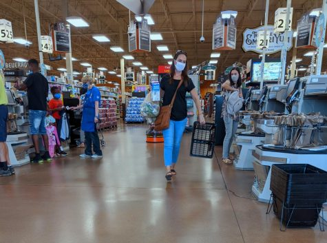 Shoppers in August  check out their groceries, while following the mandatory mask rules at Kroger on Dupont Road.