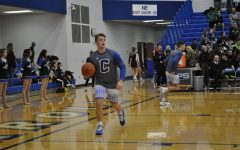Seen last season, Senior Forward Sam Strycker warms up for a home match. This season, the team looks to build upon last years SAC Holiday Championship success. File photo.