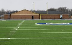 The locker room building seen from across the field.