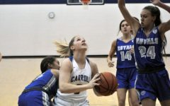 Senior Emily Parrett, G, drives the lane against Hamilton SE. The girls fell to the 6th-ranked Royals 51-47.