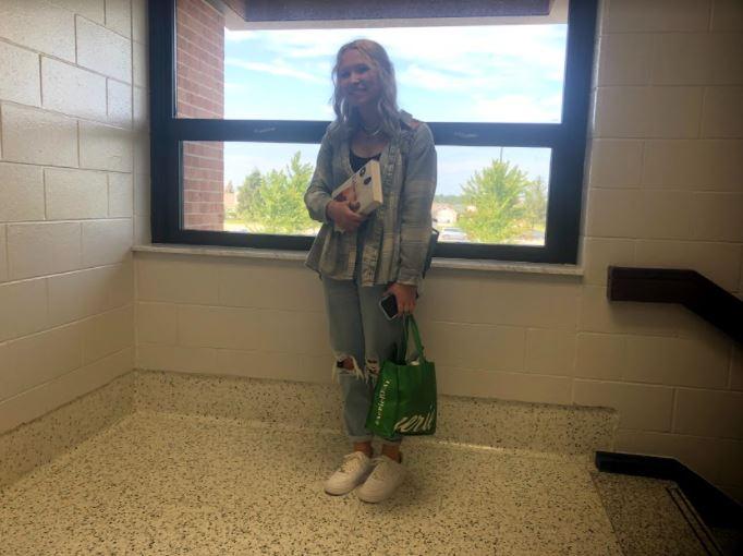 Bailey Hunt, senior, wears white Nike shoes with no socks