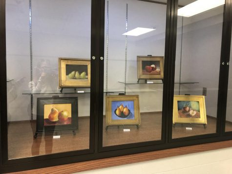 Display case in the school. Includes painting by Mattison Houser.