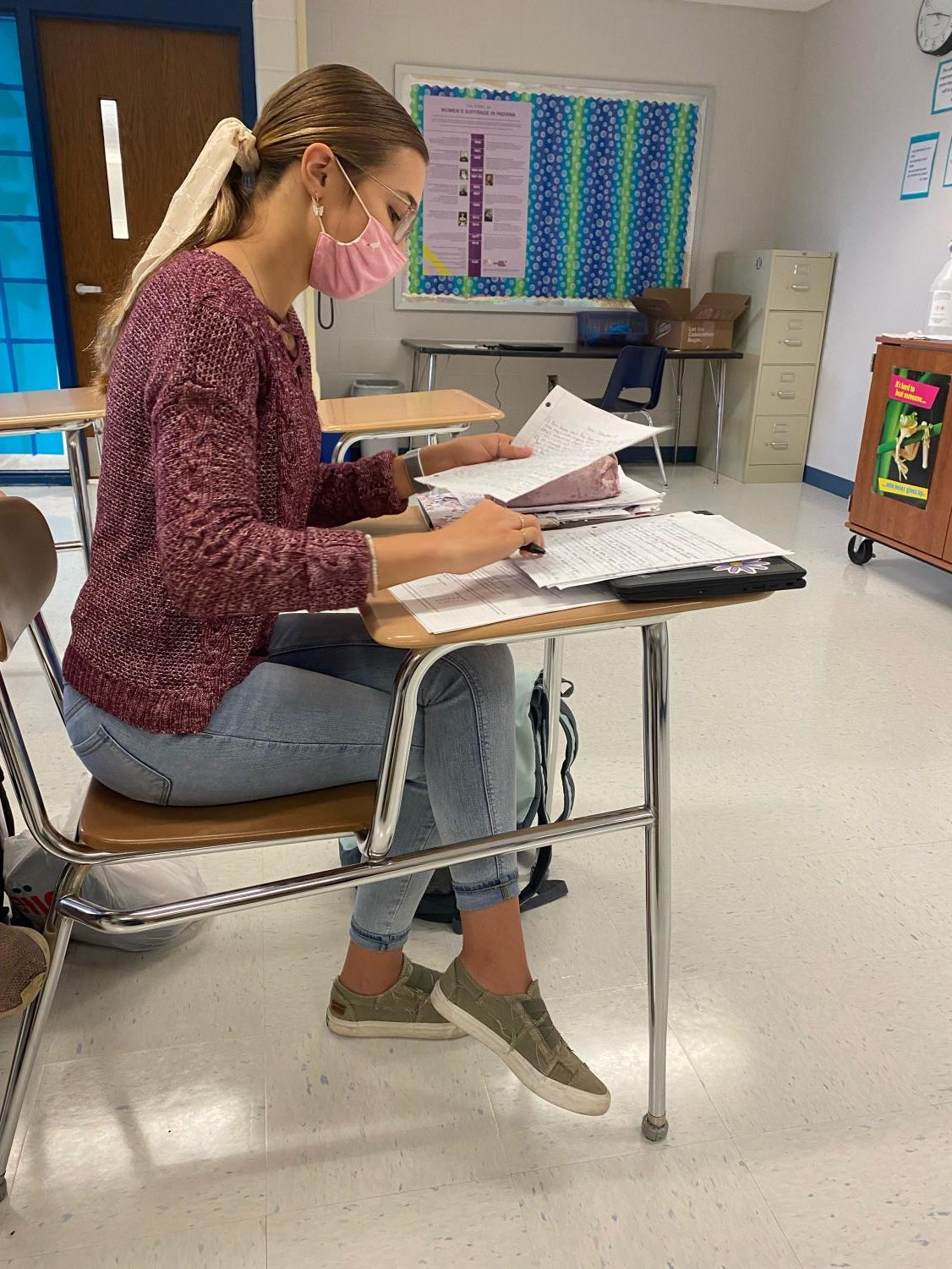Senior Grace Lane studying in the classroom.